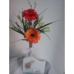 Jardinera de vidre amb flor...
